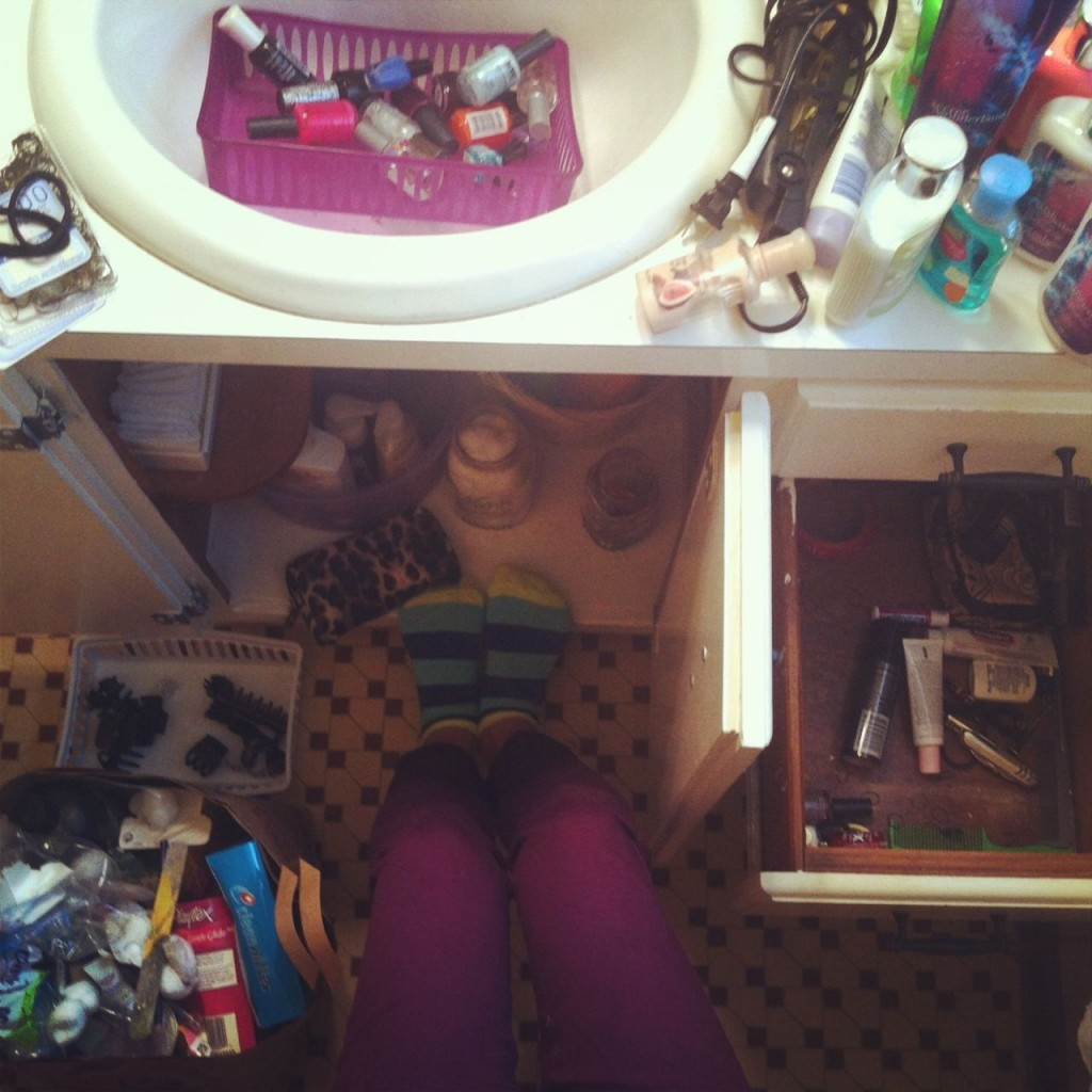 Wearing a pair of my new socks, while cleaning out my vanity cabinet.  A not fun job, made better with new/fun socks.