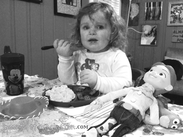 little girl eating dinner