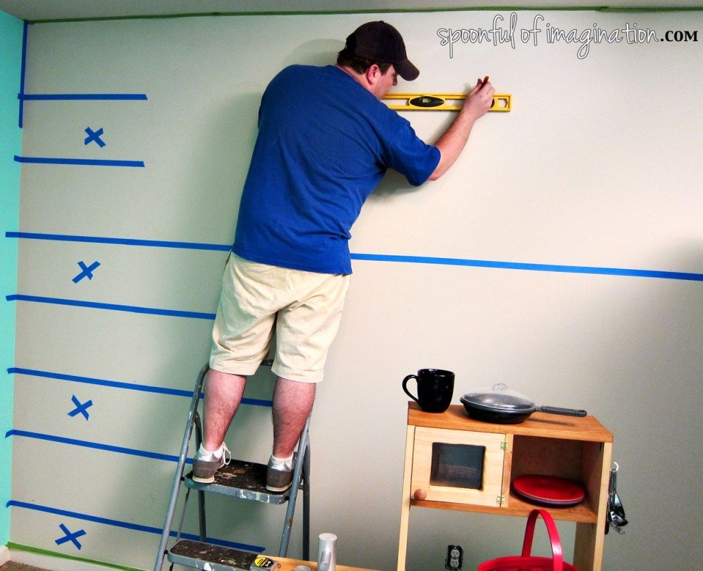 taping lines off to stripe wall